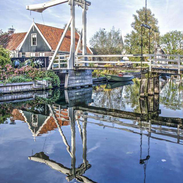 """White wooden drawbridge reflecting"" stock image"