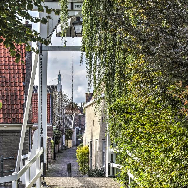 """drawbridge and narrow street"" stock image"