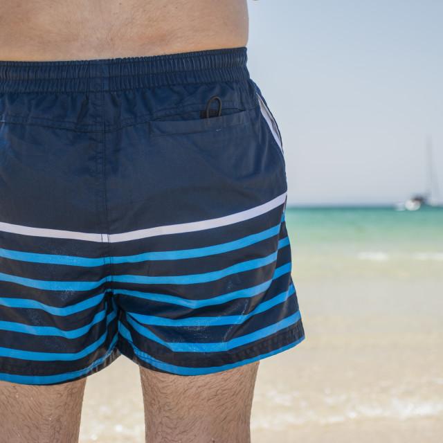"""Man swinsuit at the beach"" stock image"