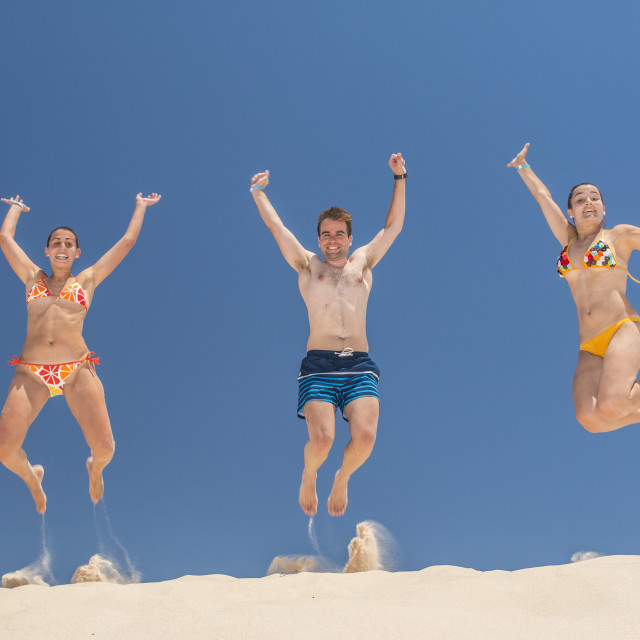 """""""People jumping in summer"""" stock image"""