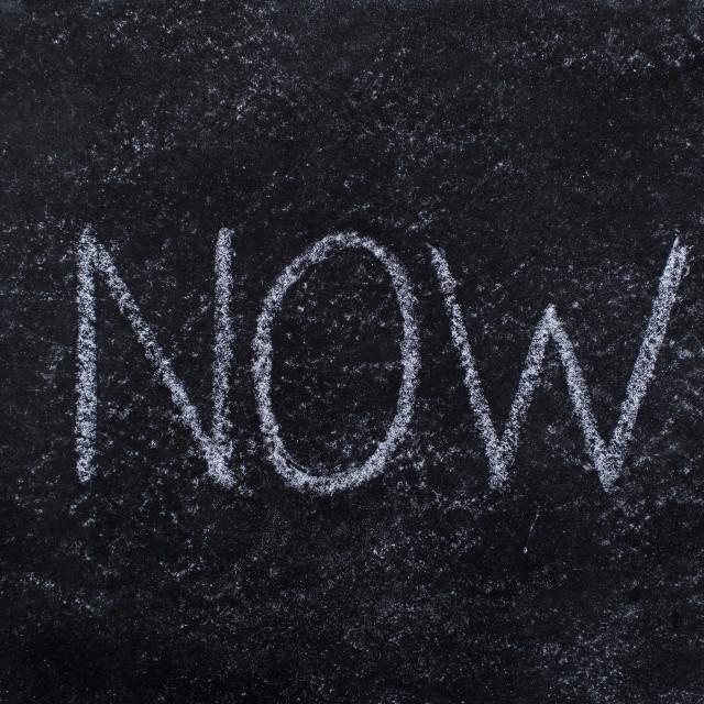 """""""NOW written on blackboard"""" stock image"""