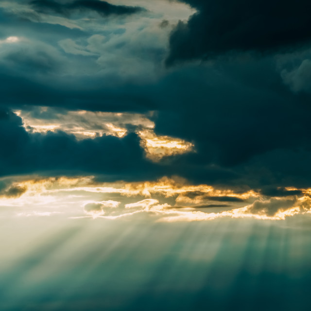 """""""Beautiful Sunshine Rays In Grey Clouds After Powerful Storm"""" stock image"""