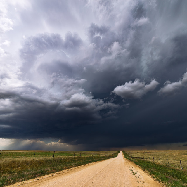 """Stormy sky and dirt road."" stock image"