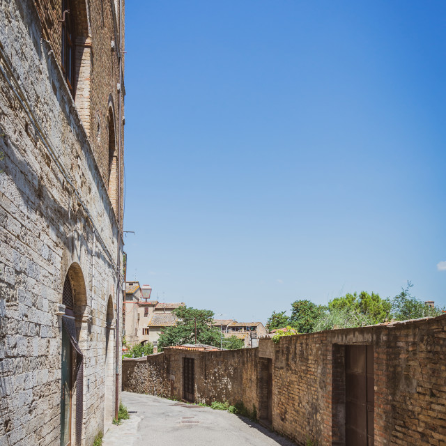 """""""Empty street on the edge of ancient town in Italy San Gimignano"""" stock image"""