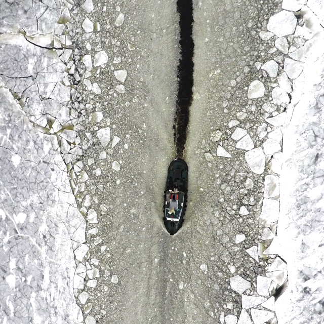 """""""TUGBOAT IN THE ICE CHANNEL"""" stock image"""