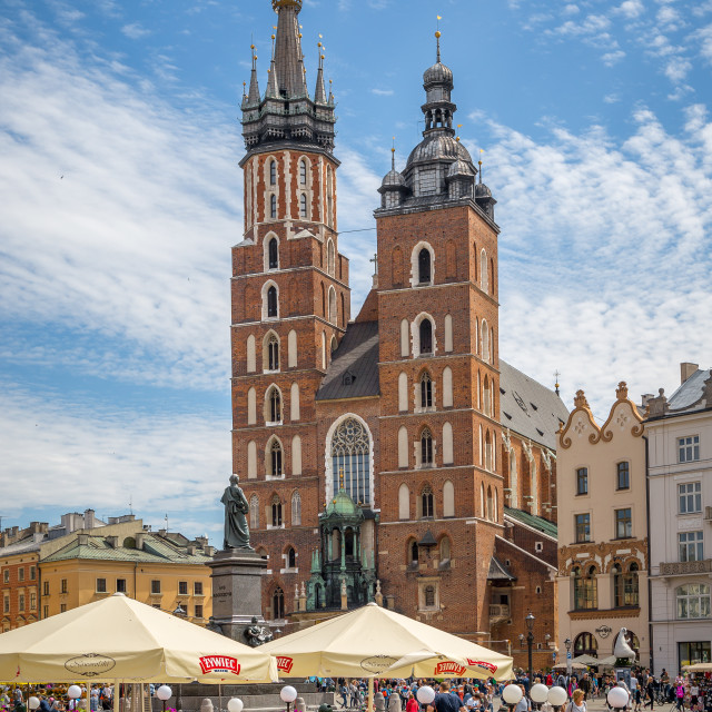 """Saint Mary's Basilica on Main Market Square in Krakow, Polant. Kościół Wniebowzięcia Najświętszej Maryi Panny, Kościół Mariack. Historical and tourist landmark and travel destination in Eourope. Vacation traveling and tourist concept."" stock image"