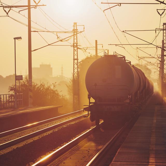 """Freight train at sunrise"" stock image"