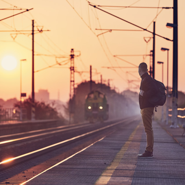 """Alone man waiting at railroad station"" stock image"