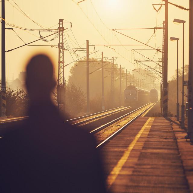 """""""Man waiting at railroad station"""" stock image"""