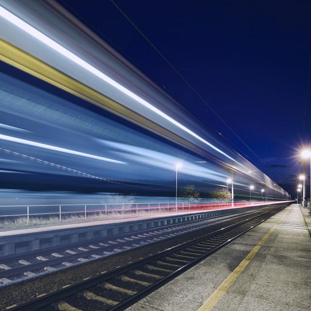 """""""Light trails of passenger train"""" stock image"""