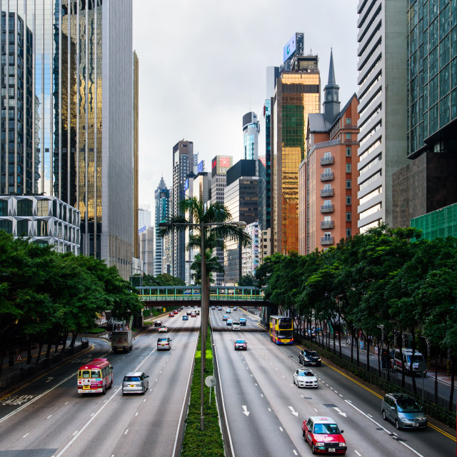 """""""Morning traffic in Hong Kong downtown area with modern buildings surrounding"""" stock image"""