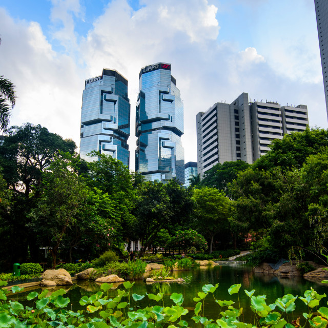 """""""Hong Kong park in the downtown surrounded by modern buildings at sunrise"""" stock image"""