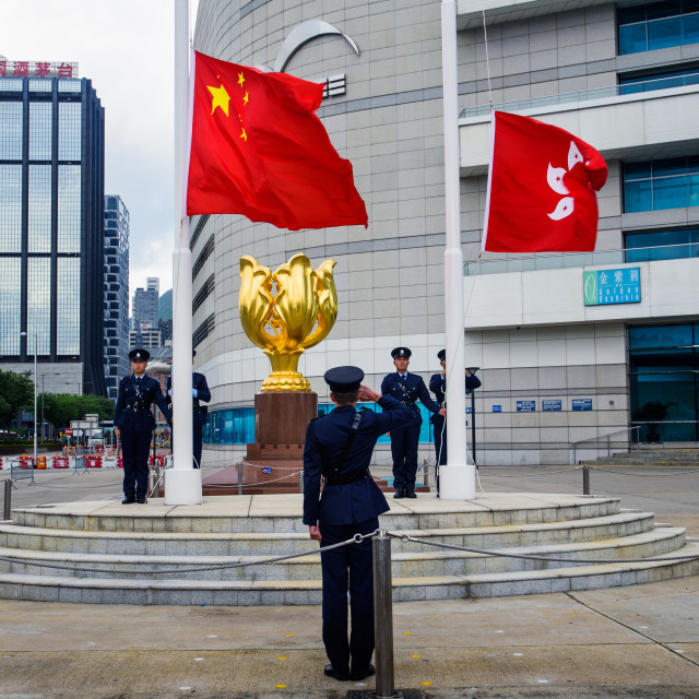 """""""Soldiers performing China and Hong Kong flag rising ceremony at the Golden Bauhinia Square"""" stock image"""