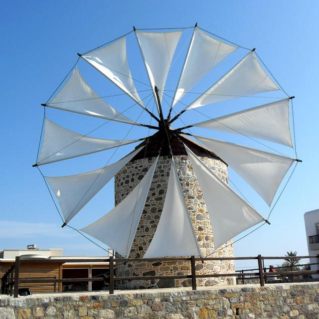 """Windmill on Greek island"" stock image"