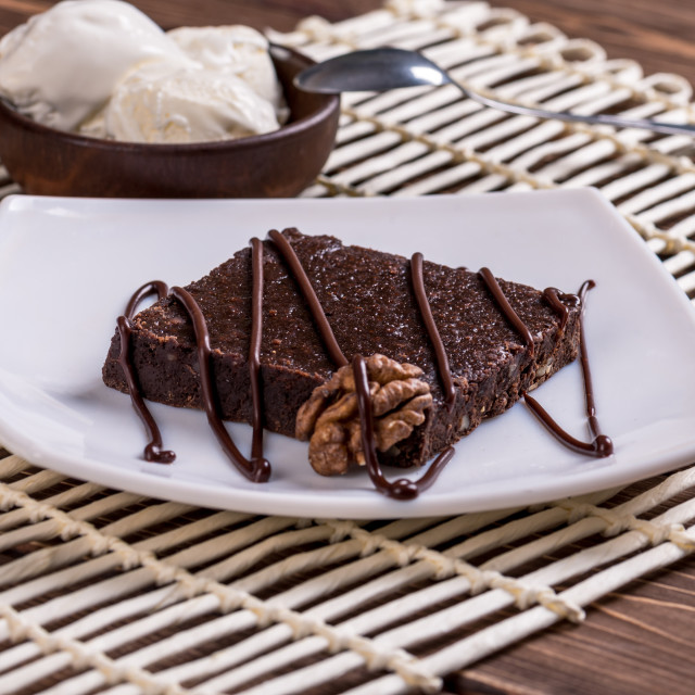 """""""Chocolate cake with cream at the fair."""" stock image"""