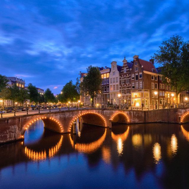 """""""Amterdam canal, bridge and medieval houses in the evening"""" stock image"""