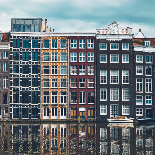 """""""houses and boat on Amsterdam canal Damrak with reflection. Ams"""" stock image"""