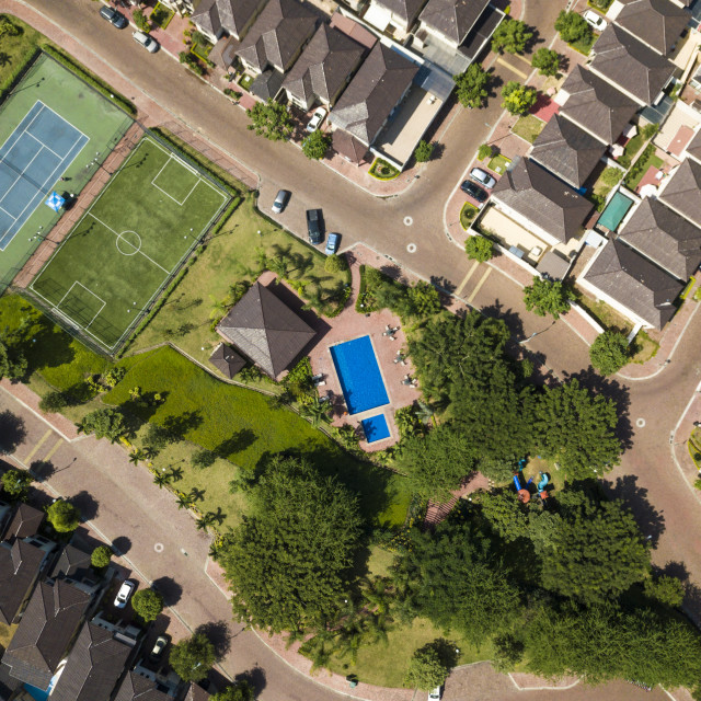 """An aerial view of houses of a gated"" stock image"