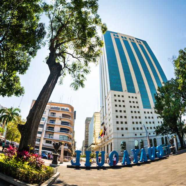 """A wide angle view of Malecon Simon Bolivar and La Previsora building in downtown Guayaquil"" stock image"