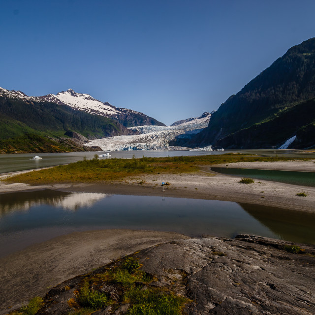 """""""A Magnificent view of a slowly retreating Mendenhall Glacier and its reflectionAlaska"""" stock image"""