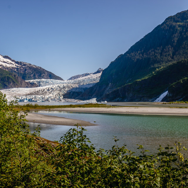 """A Magnificent view of a slowly retreating Mendenhall Glacier Alaska"" stock image"