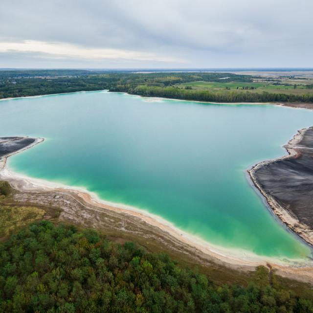 """Azure lake ""Osadnik Gajowka"" top view, abstract fantasy green and brown pattern background"" stock image"