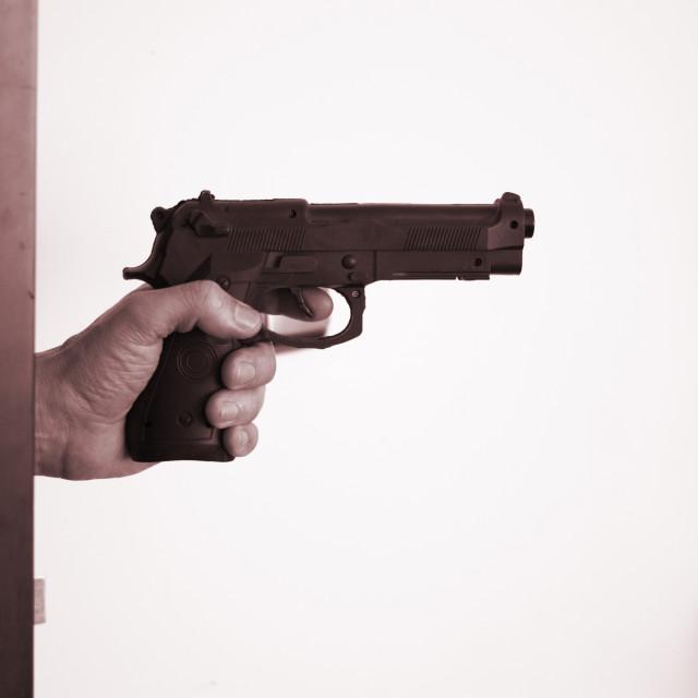"""""""Hand holding pistol gun"""" stock image"""