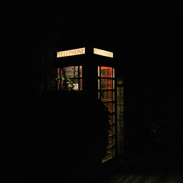 """""""Red Telephone Box in the Night"""" stock image"""