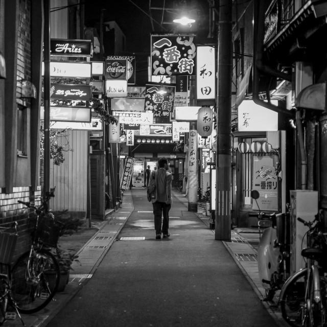 """Backstreet Lights in Japan - Man"" stock image"