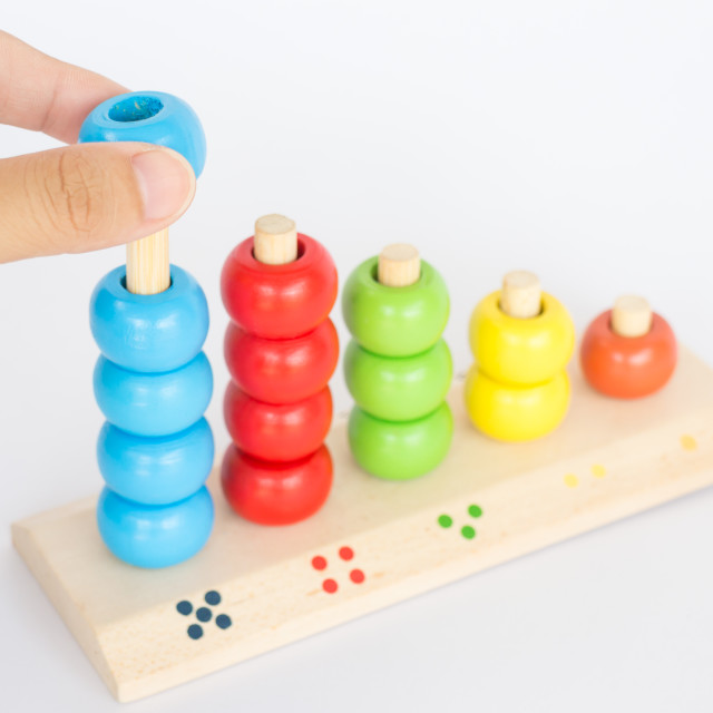 """""""Playing colorful backgammon wooden toy"""" stock image"""