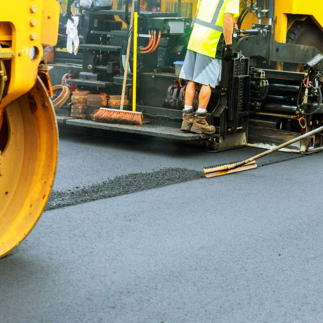"""Road roller a road construction paver laying fresh asphalt pavement during road"" stock image"