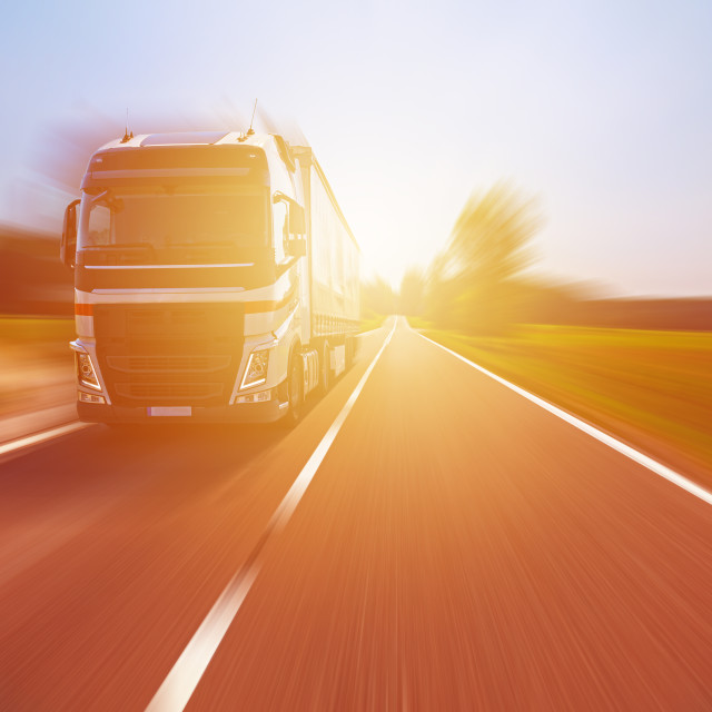 """""""Truck on the road at sunset"""" stock image"""