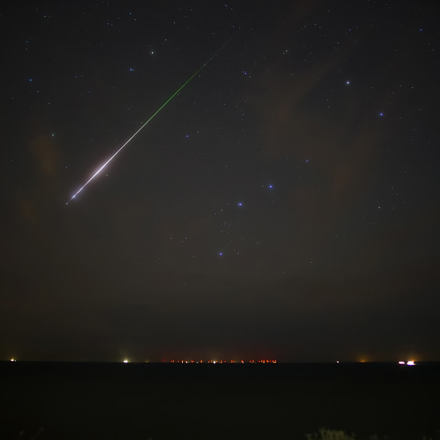 """A large Draconid meteor falls from the sky"" stock image"