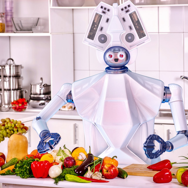 """Robot domestic assistance cook vegetarian food at kitchen."" stock image"