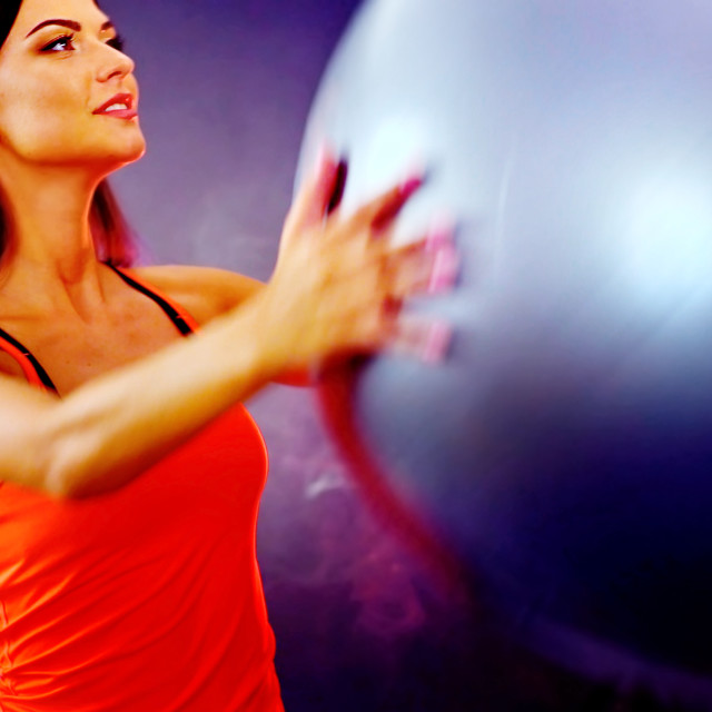 """Fitness girl exercising in gym with fitball."" stock image"