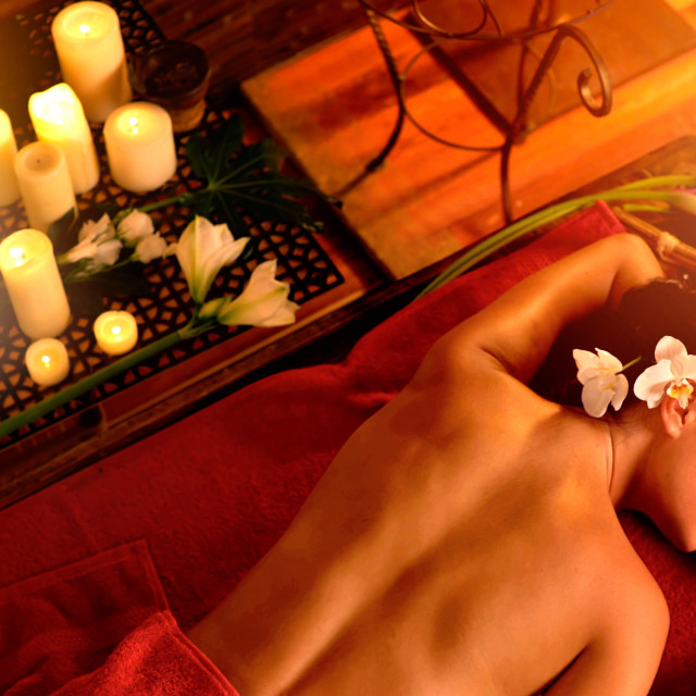 """Massage of woman in spa salon. Luxary interior oriental therapy."" stock image"