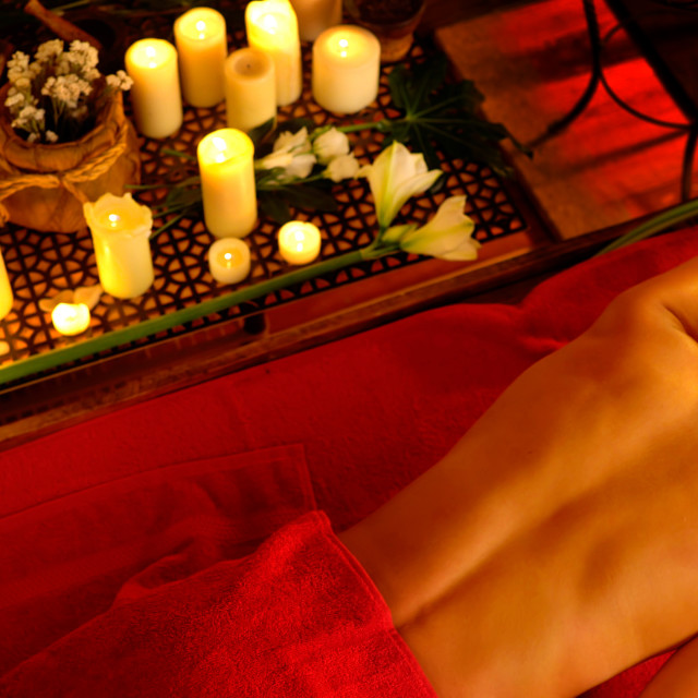 """Massage of woman in spa salon. Luxary interior oriental therapy ."" stock image"