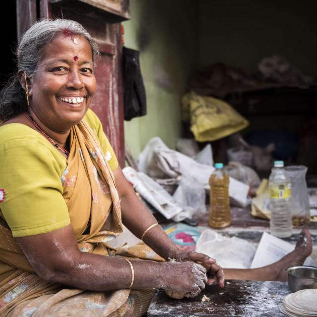 """Portrait of an Indian woman making chapati in Fort Kochi (Cochin), Kerala, India"" stock image"