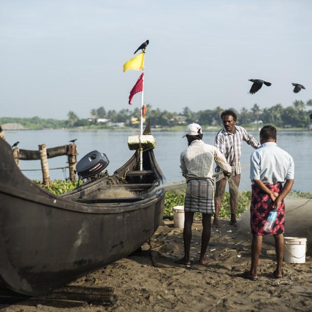 """Fishermen on Mahatma Gandhi Beach, Fort Kochi (Cochin), Kerala, India"" stock image"