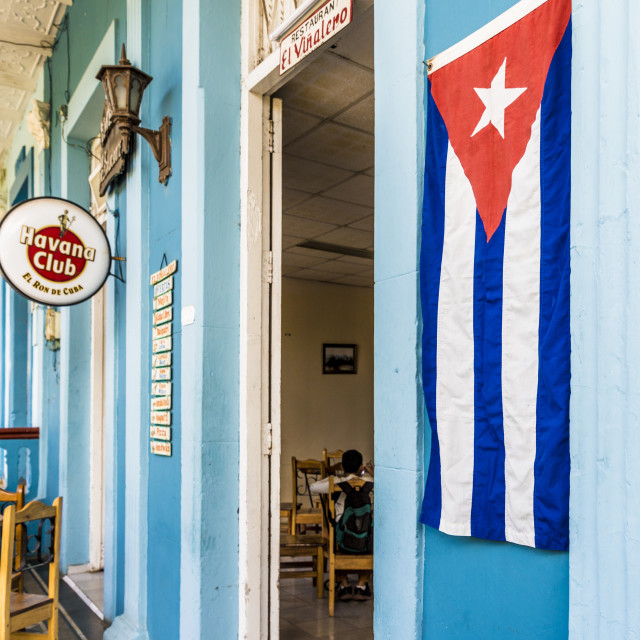 """""""A Cuban flag outside a restaurant in Vinales town in Vinales, Pinar del Rio,..."""" stock image"""