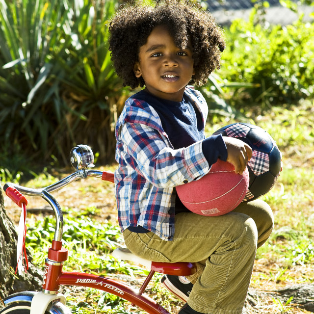 """Boy On Tricycle"" stock image"