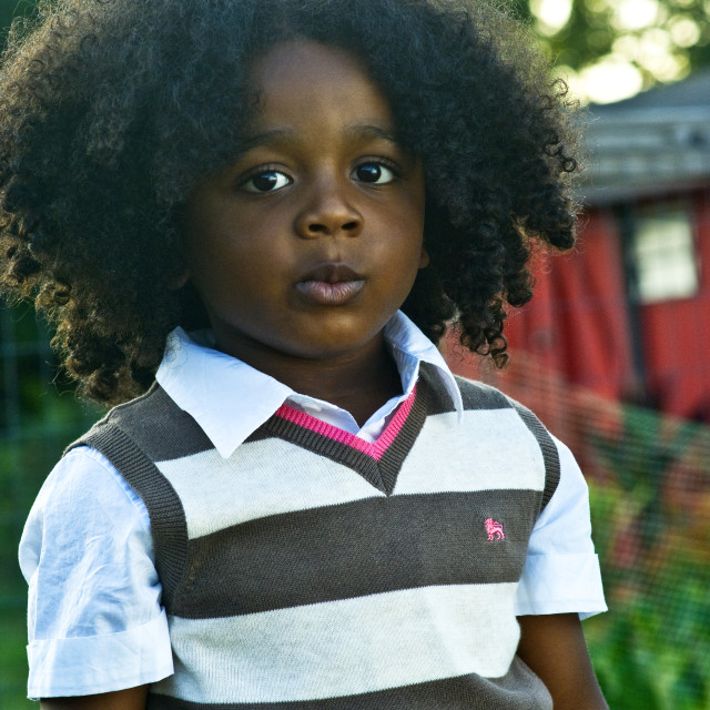 """Boy With Big Hair"" stock image"
