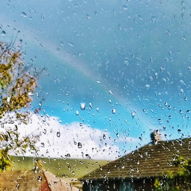 """Raindrops with a rainbow"" stock image"