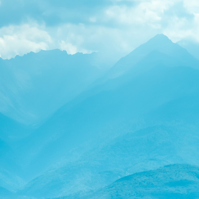 """""""Blue Mountain Crests With Mist Landscape"""" stock image"""