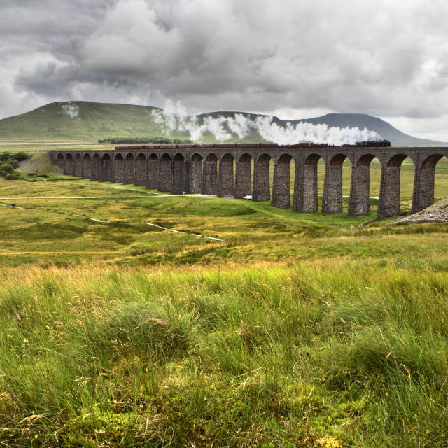 """""""Steam Train Crossing the Ribblehead Viaduct in the Yorkshire Dales"""" stock image"""