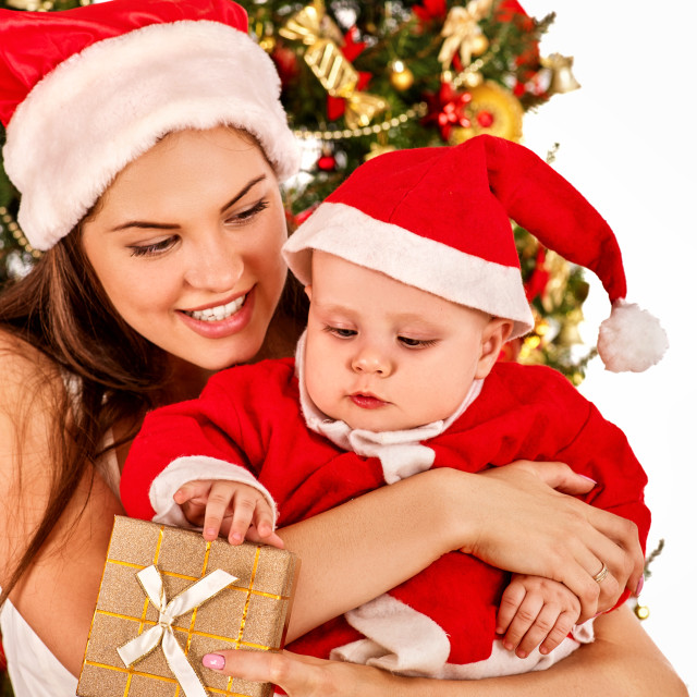 """Happy Christmas family mother and son open gift box."" stock image"