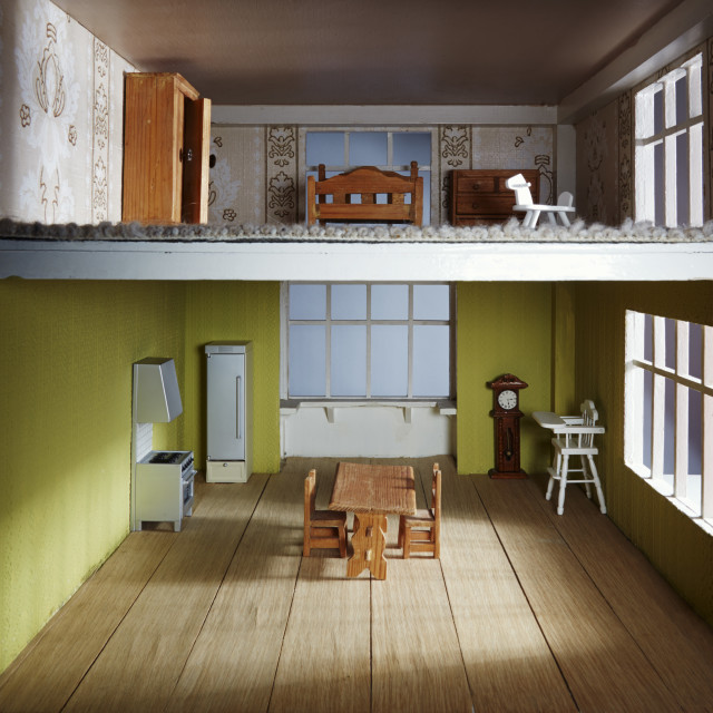 """Upstairs downstairs in a dolls house"" stock image"