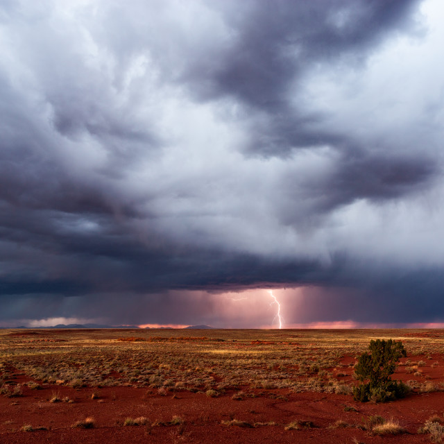 """""""Stormy sky with dramatic, dark clouds and lightning."""" stock image"""