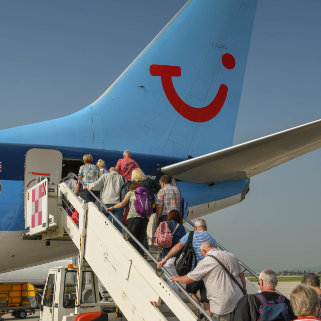 """""""Passengers boarding a holiday jet"""" stock image"""