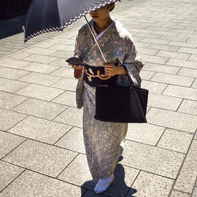 """Kimono, parasol, smart phone"" stock image"